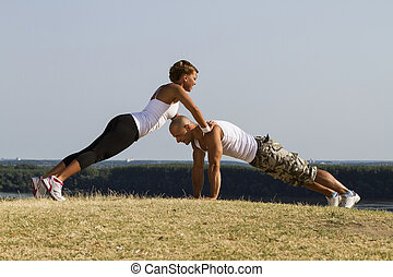 Male and female practising in nature Beautiful view in...