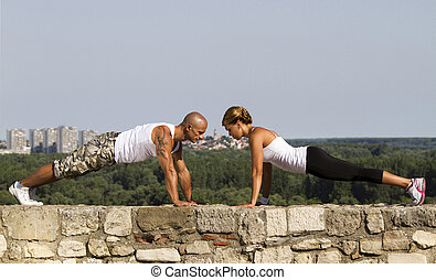 Pushups on a stone wall - Fitness instructors doing pushups...