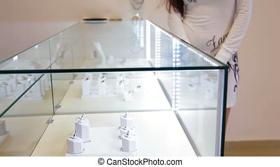 Shopping in Jewelry Store - Choosing Engagement Ring in...