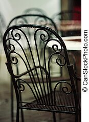 Picturesque nook - Beautiful old chair in street cafe in...