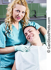 Female dentist with satisfied client