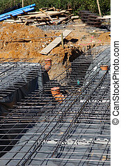 Underlying structure of a new cement floor showing steel...