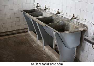Washbasins at Robben Island Prison in Cape Town, South...