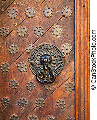 Old-fashioned door with doorhandle - Old-fashioned wooden...