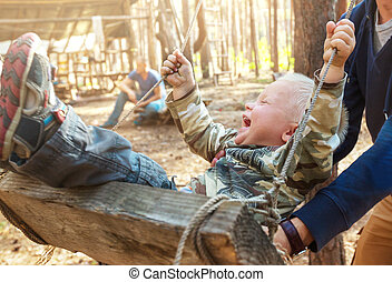 Playing boy - Laughing boy on swing