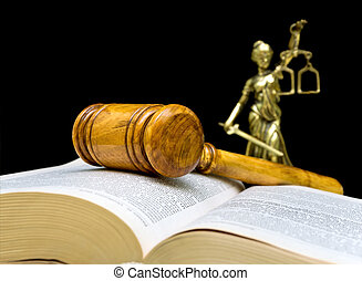 gavel on a black background closeup - gavel, law book and...