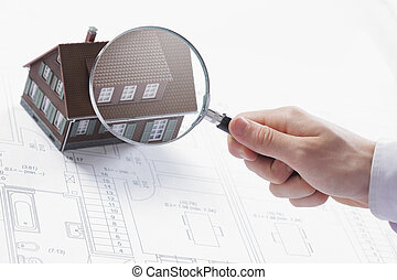 Magnifying glass and house - Concept image of a home...
