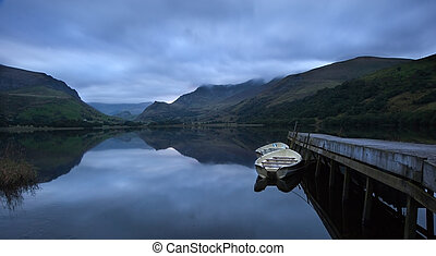 View of Snowdon covered in cloud at sunrise from Llyn...
