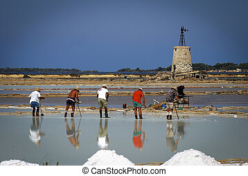 Saltworks with workers, Italy