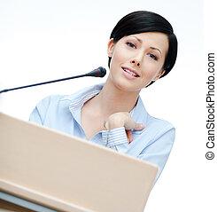 Woman speaker at the podium - Female speaker at the podium....