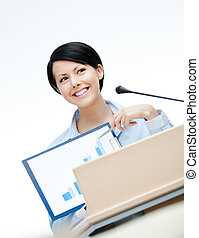 Female speaker at the podium - Female executive at the board...