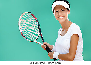 Athletic woman plays tennis - Woman in sportswear plays...