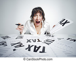 Taxes - Young frightened woman shouting out while sitting at...