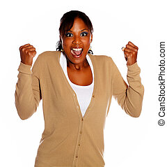 Friendly woman celebrating a victory and screaming