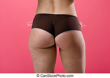 Adult female posing from behind wearing panties