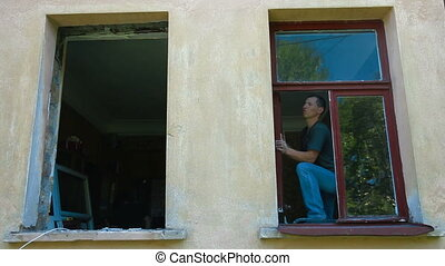 Home Renovation - Contractor demolishing the old window...