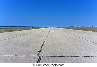 Airport Runway - old airport runway under blue sky