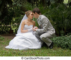 Bride and groom in a park