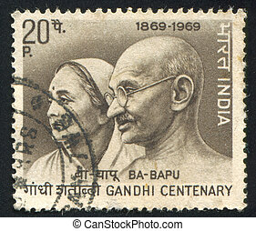 Mahatma Gandhi and wife Kasturba - INDIA - CIRCA 1969: stamp...