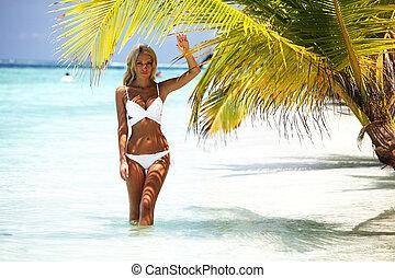 woman under palm sea on backgroud
