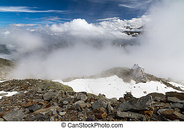 Mountain hut view - Clouded view in the Swiss Alps with a...