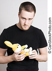 man holding a bunny - man holding a toy bunny