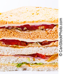 vegetable sandwich cut into triangle, on white background