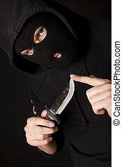 balaclava - evil criminal with a knife wearing balaclava