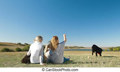 Enjoying in the Nature with Dogs - People enjoying in the...