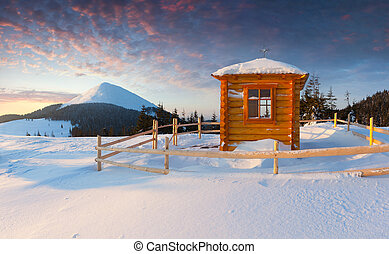 A small chapel in the mountains at the winter morning