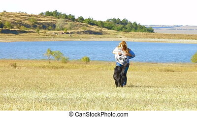 Young Woman Running With her Dog - Young Woman Running With...