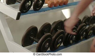 Young black man taking weights from - Sport and fun, young...