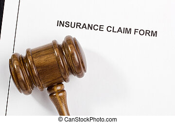 Insurance Claim Form - Directly above photograph of an...