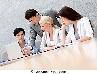 Business people discuss the plan - Business people discuss...
