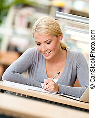 Student working at the desk