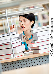 Student surrounded with books in panic