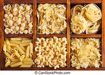 Pasta variety in wooden compartmented box - top view