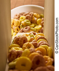 Cereal loops pouring out of a box