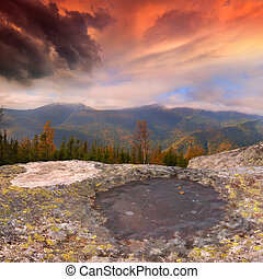Dramatic autumn landscape in the mountains. Sunset