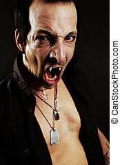 Fierce vampire - Photo of a male vampire with mouth open and...