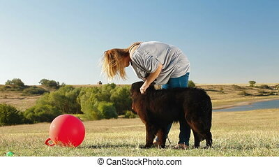 Woman With Newfoundland Dog Outdoor - Young Woman Training...