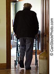 Elderly man use a walker (walking frame) - An old disabled...