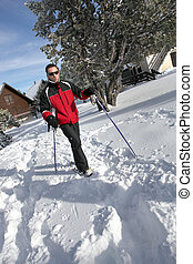 Man cross-country skiing