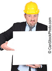 Businessman in a hardhat with a board left blank for your message