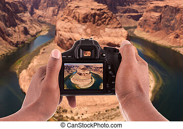Photographer taking pictures of the Horseshoe bend of...