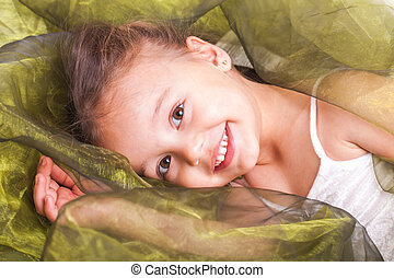 Little girl - A little girl playing around in lots of...