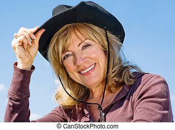 Country Western Beauty - Portrait of a beautiful mature...