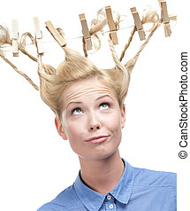Woman with creative hairdo of clothespins