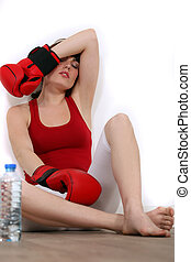 Exhausted woman with boxing gloves