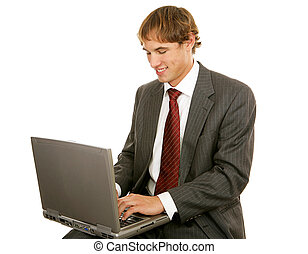 Young Businessman On Laptop - Handsome young businessman...